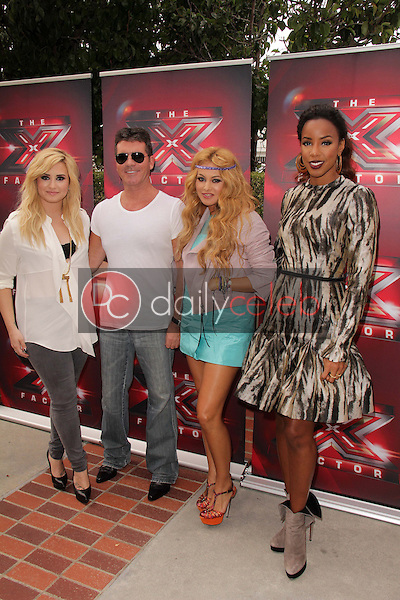 Demi Lovato, Simon Cowell, Paulina Rubio, Kelly Rowland<br /> at &quot;The X Factor&quot; Los Angeles Auditions, Galen Center, Los Angeles, CA 07-11-13<br /> David Edwards/DailyCeleb.Com 818-249-4998