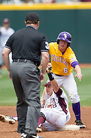 LSU Tigers outfielder Andrew Stevenson (6) and Texas A&M Aggies shortstop Mikey Reynolds (16) look to the umpire waiting for the call in the NCAA Southeastern Conference baseball game on May 11, 2013 at Blue Bell Park in College Station, Texas. LSU defeated Texas A&M 2-1 in extra innings to capture the SEC West Championship. (Andrew Woolley/Four Seam Images).