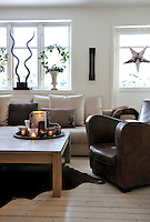 Tea lights introduce a warm glow to the calm, brown tones of the living room