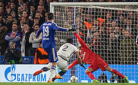Diego Costa of Chelsea scores his goal past Goalkeeper Kevin Trapp of Paris Saint-Germain during the UEFA Champions League Round of 16 2nd leg match between Chelsea and PSG at Stamford Bridge, London, England on 9 March 2016. Photo by Andy Rowland.
