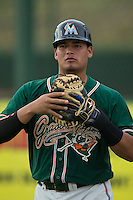Greensboro Grasshoppers catcher Rodrigo Vigil (27) warms up in the outfield prior to the game against the Kannapolis Intimidators at CMC-Northeast Stadium on June 9, 2015 in Kannapolis, North Carolina.  The Intimidators defeated the Grasshoppers 6-4.  (Brian Westerholt/Four Seam Images)