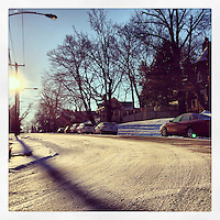 A thin layer of snow still covers the intersection of Pelham Road and Emlen Street in the Mt. Airy section of Philadelphia, January 27, 2013.
