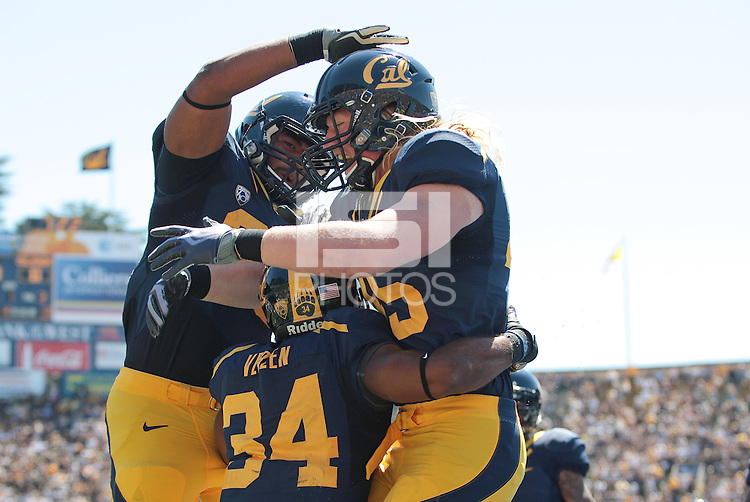 Anthony Miller (let) and Spencer Ladner (45) celebrate with Shane Vereen (34) after his touchdown. The California Golden Bears defeated the Colorado Buffaloes 52-7 at Memorial Stadium in Berkeley, California on September 11th, 2010.