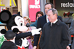 Aden Schwartz, Mickey Mouse, Mayor Michael Bloomberg, and Robert Iger on stage at the Disney Store grand opening in Times Square, November 9, 2010.