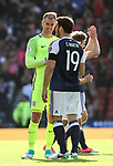 Scotland's Chris Martin shares a joke with England's Joe Hart during the FIFA World Cup Qualifying match at Hampden Park Stadium, Glasgow Picture date 10th June 2017. Picture credit should read: David Klein/Sportimage