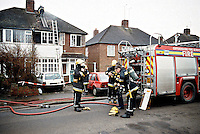 Firefighters wearing Breathing Apparatus preparing to enter a home to deal with a severe fire. This image may only be used to portray the subject in a positive manner..©shoutpictures.com..john@shoutpictures.com