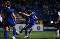 Seattle, Washington -  Sunday, September 11 2016: Seattle Reign FC midfielder Keelin Winters (11) takes a shot on goal during a regular season National Women's Soccer League (NWSL) match between the Seattle Reign FC and the Washington Spirit at Memorial Stadium. Seattle won 2-0.