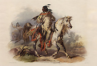 Blackfoot Indian on Horseback, hand-coloured aquatint and etching, 1835-45, by Karl Bodmer, 1809-93, Swiss artist, from the collection of Denver Art Museum, Denver, Colorado, USA. The Blackfoot or Siksika is depicted riding a horse, carrying a gun, wearing moccasins, leggings, hide clothing, and feathers in his hair. Picture by Manuel Cohen
