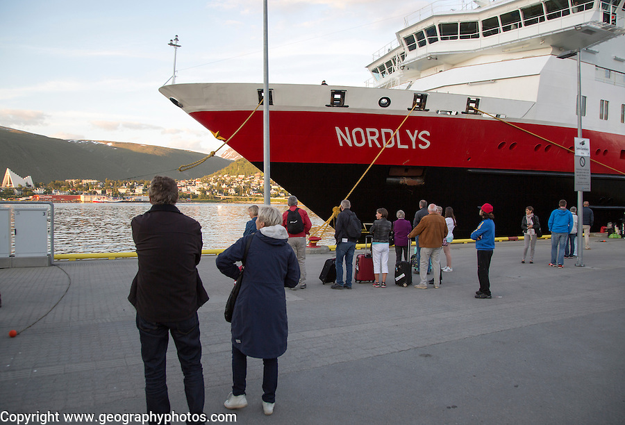 Hurtigruten ferry ship Nordlys with waiting passengers moored at Tromso, Norway