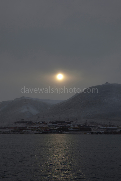 The sun pushes through a fog over the town of Longyearbyen, Svalbard. The northernmost settlement with more than 1,000 people on earth, and is quite well-serviced town, with an airport and university and hospital, just 1300km from the North Pole.
