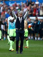 Manchester City manager Manuel Pellegrini waves to the fans at full time during the Barclays Premier League match between Swansea City and Manchester City played at The Liberty Stadium, Swansea on 15th May 2016
