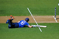 Eoin Morgan dives to make his ground during the ICC Cricket World Cup one day pool match between the New Zealand Black Caps and England at Wellington Regional Stadium, Wellington, New Zealand on Friday, 20 February 2015. Photo: Dave Lintott / lintottphoto.co.nz
