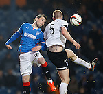 Nicky Clark has the ball stolen from his head by Alan Lithgow