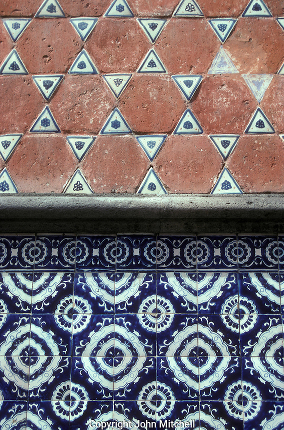 Blue and white Talavera tiles on the exterior wall of a Spanish colonial building in the city of Puebla, Mexico