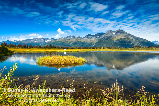 Chugach Mountains reflect on Robe Lake, Valdez, Southcentral Alaska, Autumn.