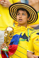 Columbia fan with a world cup trophy