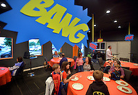 NWA Democrat-Gazette/BEN GOFF -- 05/29/15 Families dressed as their favorite superheroes enjoy pizza before the movie on Popcorn Theology night at The Neighborhood Church in Bentonville on Friday May 29, 2015. Popcorn Theology programs feature a movie, this time the film was 'The Incredibles,' followed by a discussion of where religious themes could be seen in the movie.