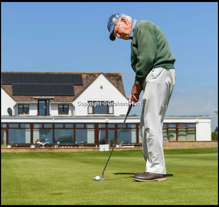 BNPS.co.uk (01202 558833)<br /> Pic: GrahamHunt/BNPS<br /> <br /> Lindley Baker on the 18th green at Lyme Regis Golf Club, Dorset.<br /> <br /> One of Britain's oldest golfers has swung himself into the record books at the age of 97.<br /> <br /> Sprightly Lindley Baker has been a member of the same Dorset club since 1937, making him the country's longest-paying golf club member. <br /> <br /> Since joining 80 years ago Mr Baker has struck the ball a whopping 330,000 times and completed more than 4,000 rounds. <br /> <br /> The par 71 Lyme Regis Golf Club course is 5,688 yards long, meaning that over the years Mr Baker has walked nearly 13,000 miles there, which is half way around the world.