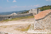 The old Ottoman garrisons garnison building that housed the soldiers. Background: city wall and view over the valley. Berat upper citadel old walled city. Albania, Balkan, Europe.