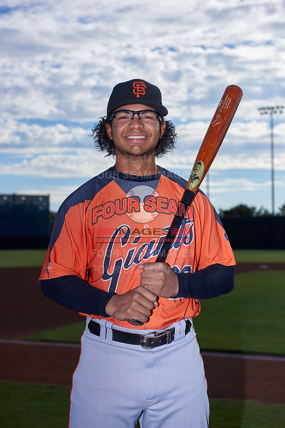 AZL Giants Orange infielder Luis Toribio (22) poses for a photo before an Arizona League game against the AZL Giants Black on July 19, 2019 at the San Francisco Giants Baseball Complex in Scottsdale, Arizona. The AZL Giants Black defeated the AZL Giants Orange 8-5. (Zachary Lucy/Four Seam Images)