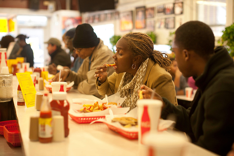 ©2012 David Burnett/.Contact Press Images.Washington DC.November 16 2012..clients at Ben's Chili Bowl,  U street (& 13th) in U Street corridor