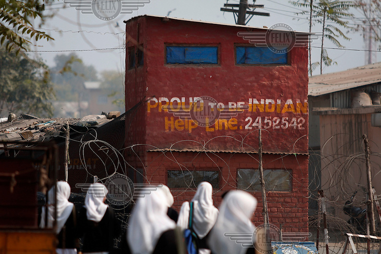 Indian police bunker with slogan considered provocative by locals in the area. Srinagar, Kashmir, India. © Fredrik Naumann/Felix Features