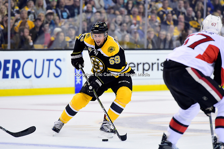April 23, 2017: Boston Bruins left wing Tim Schaller (59) works the puck through he neutral zone during the game 6 of the National Hockey League Eastern Conference quarterfinal Stanley Cup playoff between the Ottawa Senators and the Boston Bruins held at TD Garden, in Boston, Mass. Ottawa eliminates Boston 3-2 in overtime taking the series 4 games to 2. Eric Canha/CSM