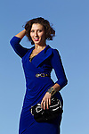 09/30/12--Silkwood Sales Associate Adriana Chepiga fashions a blue dress made by Joseph Ribkoff a studded black purse by Izzy & Ali, and a Geranium necklace....Photo by Jaime Valdez..... ..