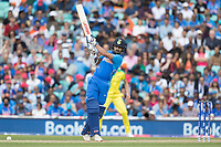 Shikhar Dhawan (India) advances down the wicket and flays Nathan Coulter-Nile (Australia) straight for four during India vs Australia, ICC World Cup Cricket at The Oval on 9th June 2019