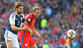 June 10th 2017, Hampden park, Glasgow, Scotland; World Cup 2018 Qualifying football, Scotland versus England; Charlie Mulgrew and Harry Kane challenge for a loose ball