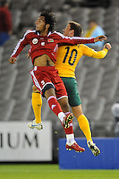 MELBOURNE, AUSTRALIA - OCTOBER 14: Harry Kewell from Australia fighting for the ball with Mohamed Al Balushi from Oman in a AFC Asian Cup 2011 match between Australia and Oman at Etihad Stadium on October 14, 2009 in Melbourne, Australia. Photo Sydney Low www.syd-low.com