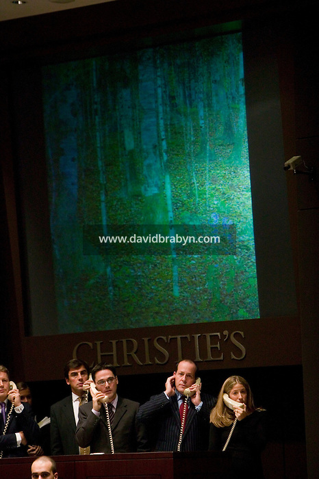 8 November 2006 - New York City, USA - Christie's employees take bids over the phone for Gustave Klimt's Birch forest (seen on screen, above) during an Impressionist and Modern Art Sale in New York City, NY, which realized $491,472,000 and nine new world auction records, 8 November 2006.
