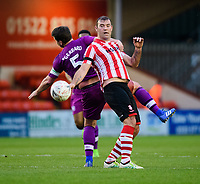 Lincoln City's Matt Rhead vies for possession with Carlisle United's Anthony Gerrard<br /> <br /> Photographer Chris Vaughan/CameraSport<br /> <br /> The Emirates FA Cup Second Round - Lincoln City v Carlisle United - Saturday 1st December 2018 - Sincil Bank - Lincoln<br />  <br /> World Copyright © 2018 CameraSport. All rights reserved. 43 Linden Ave. Countesthorpe. Leicester. England. LE8 5PG - Tel: +44 (0) 116 277 4147 - admin@camerasport.com - www.camerasport.com