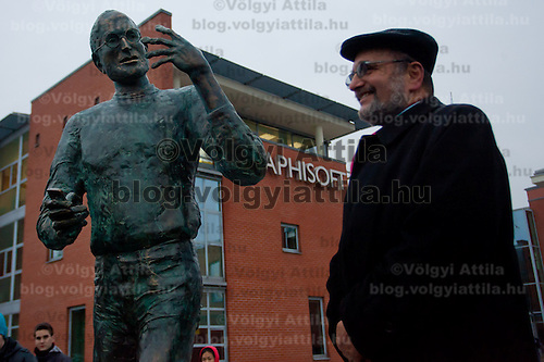 Gabor Bojar chairman of board for Graphisoft poses with first ever life-size bronze statue of late Apple leader Steve Jobs after the inauguration ceremony in Budapest, Hungary on December 21, 2011. ATTILA VOLGYI
