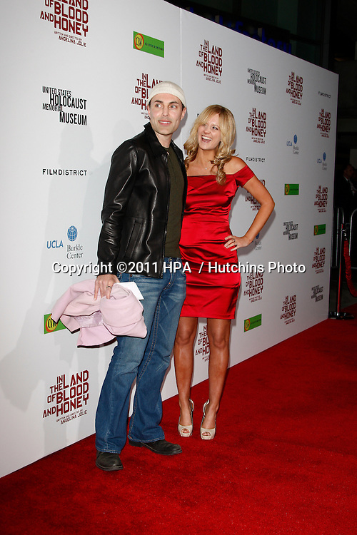 """LOS ANGELES - DEC 8:  James Haven; Ashley Reign arrives at the """"In the Land of Blood and Honey"""" LA Premiere at ArcLight Cinemas on December 8, 2011 in Los Angeles, CA"""