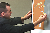 Investigator for the Hanover County (Virginia) Sheriff's Office, Drew Darby, points to locations on a diagram of the shooting scene in at the Ponderosa Steak House in Ashland, Virginia during his testimony in the trial of sniper suspect John Allen Muhammad in courtroom 10 at the Virginia Beach Circuit Court in Virginia Beach Circuit Court in Virginia Beach, Virginia, on October 31, 2003. <br /> Credit: Adrin Snider - Pool via CNP