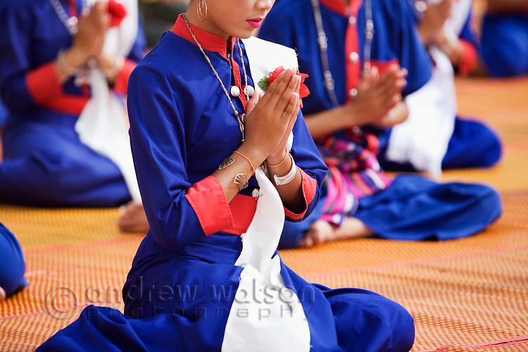 Isan dancers pray at Wat Phra That Phanom during the festival of Ok Phansa.  That Phanom, Nakhon Phanom province, THAILAND.