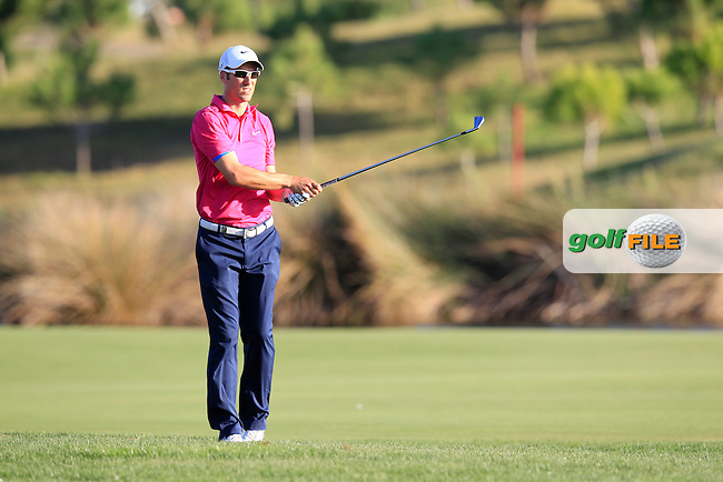 Ross Fisher (ENG) plays his 2nd shot on the 18th hole during Saturday's Round 3 of the Portugal Masters at the Oceanico Victoria Golf Course, Vilamoura, Portugal 13th October 2012 (Photo Eoin Clarke/www.golffile.ie)