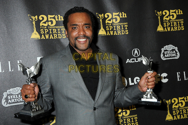 LEE DANIELS .25th Annual Film Independent Spirit Awards - Press Room held at the Nokia Event Deck at L.A. Live, Los Angeles, California, USA, 5th March 2010..indie half length grey gray suit award winner trophies handlebar moustache mustache black  facial hair .CAP/ADM/BP.©Byron Purvis/AdMedia/Capital Pictures.