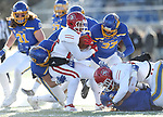 BROOKINGS, SD - NOVEMBER 17: Logan Backhaus #12 and Michael Griffin #33 from South Dakota State University gang tackle Canaan Brooks #25 from the University of South Dakota during their game Saturday afternoon at Dana J. Dykhouse Stadium in Brookings, SD. (Photo by Dave Eggen/Inertia)