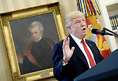 United States President Donald Trump speaks about  trade in the Oval Office of the White House, March 31, 2017 in Washington, DC. <br /> Credit: Olivier Douliery / Pool via CNP