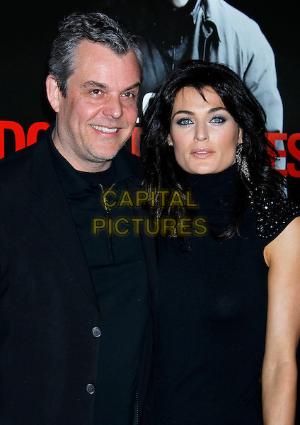 "DANNY HUSTON & LYNE RENEE .he Los Angeles premiere of ""Edge of Darkness"" at Grauman's Chinese Theatre in Hollywood, California, USA. .January 26th, 2010 .half length black jacket dress top couple.CAP/ADM/MJ.©Michael Jade/AdMedia/Capital Pictures."