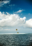 INDONESIA, Mentawai Islands, a small island with a single palm tree against cloudy sky