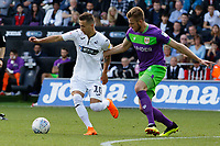 (L-R) Bersant Celina of Swansea City closely marked by Marley Watkins of Bristol City during the Sky Bet Championship match between Swansea City and Bristol City at the Liberty Stadium, Swansea, Wales, UK. Saturday 25 August 2018
