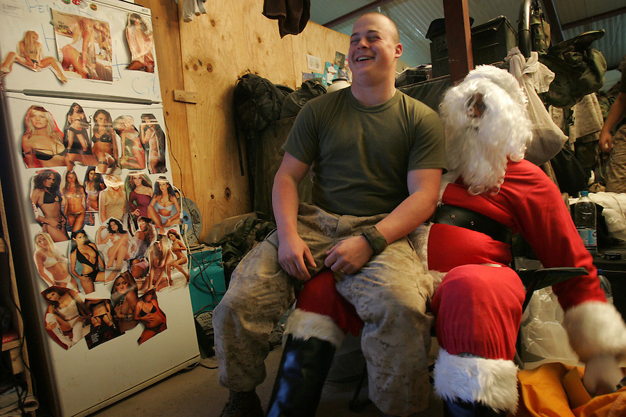Santa Claus visits the Marines of Golf Company 2nd Battalion 5th Marines at their base - Hurricane Point - in Ramadi, Iraq on Christmas Eve December 24, 2004.