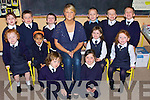 NATIONAL: Junior infants from Abbeydorney National School helping out their teacher Miss O'Connell on their first day. Front l-r Louise Ryall and Charlott Hart. Seated l-r: Keira Moore,Leah Thomas, Miss O'Connell, Ellen Fitzmaurice and Chloe Gleeson. Back l-r: Rebecca O'Sullivan,Darragh O'Connell, Jack Moynihan,Tadgh McNamara,Scott Rumgay and Brenda?in Walsh.