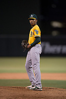 AZL Athletics relief pitcher Malik Jones (50) prepares to deliver a pitch during an Arizona League game against the AZL Angels at Tempe Diablo Stadium on June 26, 2018 in Tempe, Arizona. The AZL Athletics defeated the AZL Angels 7-1. (Zachary Lucy/Four Seam Images)