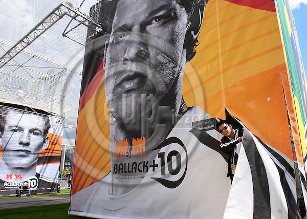 BERLIN- 7. MAY 2006 -- At the Addidas Arena (a duplicate of Berlins Olympia Station) in front of Berlin's parliaments building a large tent with a picture of German soccer player Michael Ballack. A man is looking out. Photo: EUP & IMAGES / Uffe Noejgaard .dk.