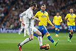 Garet Bale of Real Madrid competes for the ball with Jese Rodriguez of UD Las Palmas  during the match of Spanish La Liga between Real Madrid and UD Las Palmas at  Santiago Bernabeu Stadium in Madrid, Spain. March 01, 2017. (ALTERPHOTOS / Rodrigo Jimenez)