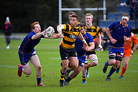 Ciarahn Matoe tries to get his pass away during the Jock Hobbs Memorial Under-19 Tournament rugby match between Taranaki and Otago at Owen Delany Park in Taupo, New Zealand on Saturday, 16 September 2012. Photo: Dave Lintott / lintottphoto.co.nz
